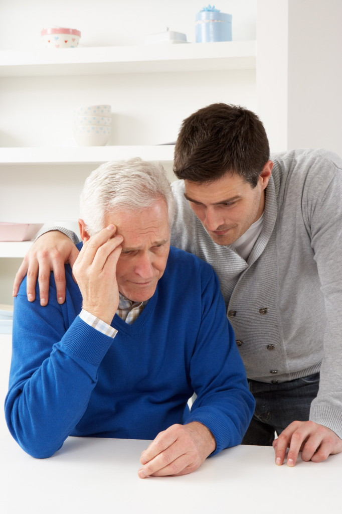 Younger Man Consoling Older Man